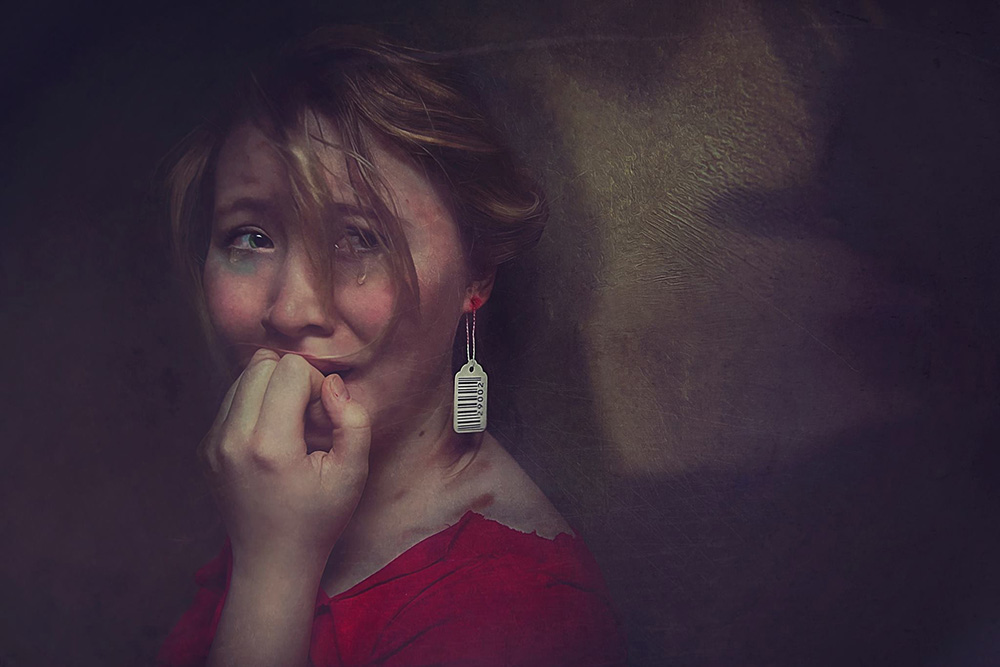 A woman crying. Photo art created by student photographer Sarah Huling.
