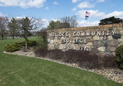 The front sign of KCC just off North Avenue on a sunny summer day.