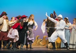 "The cast of KCC's musical ""The Pirates of Penzance"" rehearses a scene on the stage of the Binda Performing Arts Center."