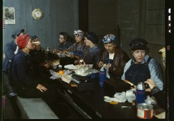 "A Library of Congress photo from 1943 titled ""Women workers employed as wipers in the roundhouse having lunch in their rest"""
