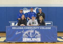 New KCC baseball signee Brendan Merians poses in a KCC signing photo with KCC baseball coaches and some family members