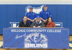 New KCC baseball signee Chris Clark poses in a KCC signing photo with KCC baseball coaches and some family members