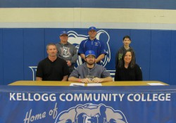 New KCC baseball signee Connor Adams poses in a KCC signing photo with KCC baseball coaches and some family members