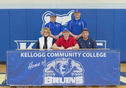 New KCC baseball signee Cooper Marshall poses in a KCC signing photo with KCC baseball coaches and some family members