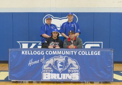 New KCC baseball signee Joseph Nate poses in a KCC signing photo with KCC baseball coaches and some family members