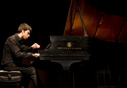 Pianist Miguel Sousa plays a piano in a provide photo used to promote Sousa's upcoming recital at KCC.