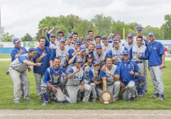 KCC's 2015 baseball team poses for a celebratory team photo on the field of C.O. Brown Stadium following their regional tournament win