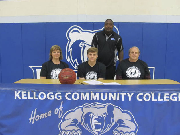 Signing photo for KCC men's basketball commit Landon Grizzle