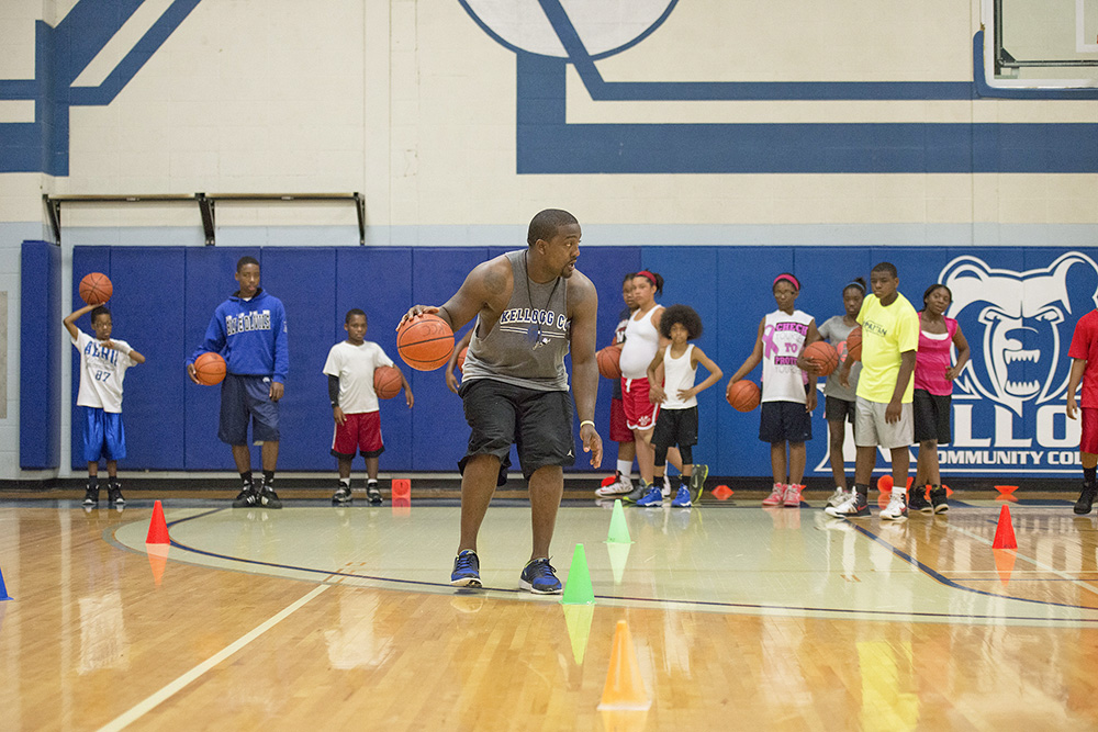 Ben Reed, head men's basketball coach at KCC, leads a basketball camp for kids in the Miller Gym.