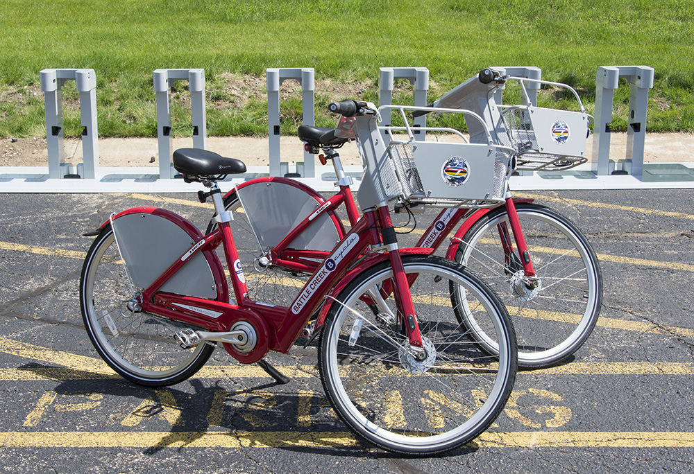 Two new red bikes, part of KCC's new B-cycle bike-sharing station, a system that lets users check bikes out for a fee for riding.