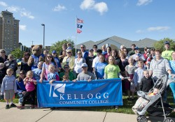 A group photo of KCC's Cereal Festival parade-walking group posing before the parade in 2014