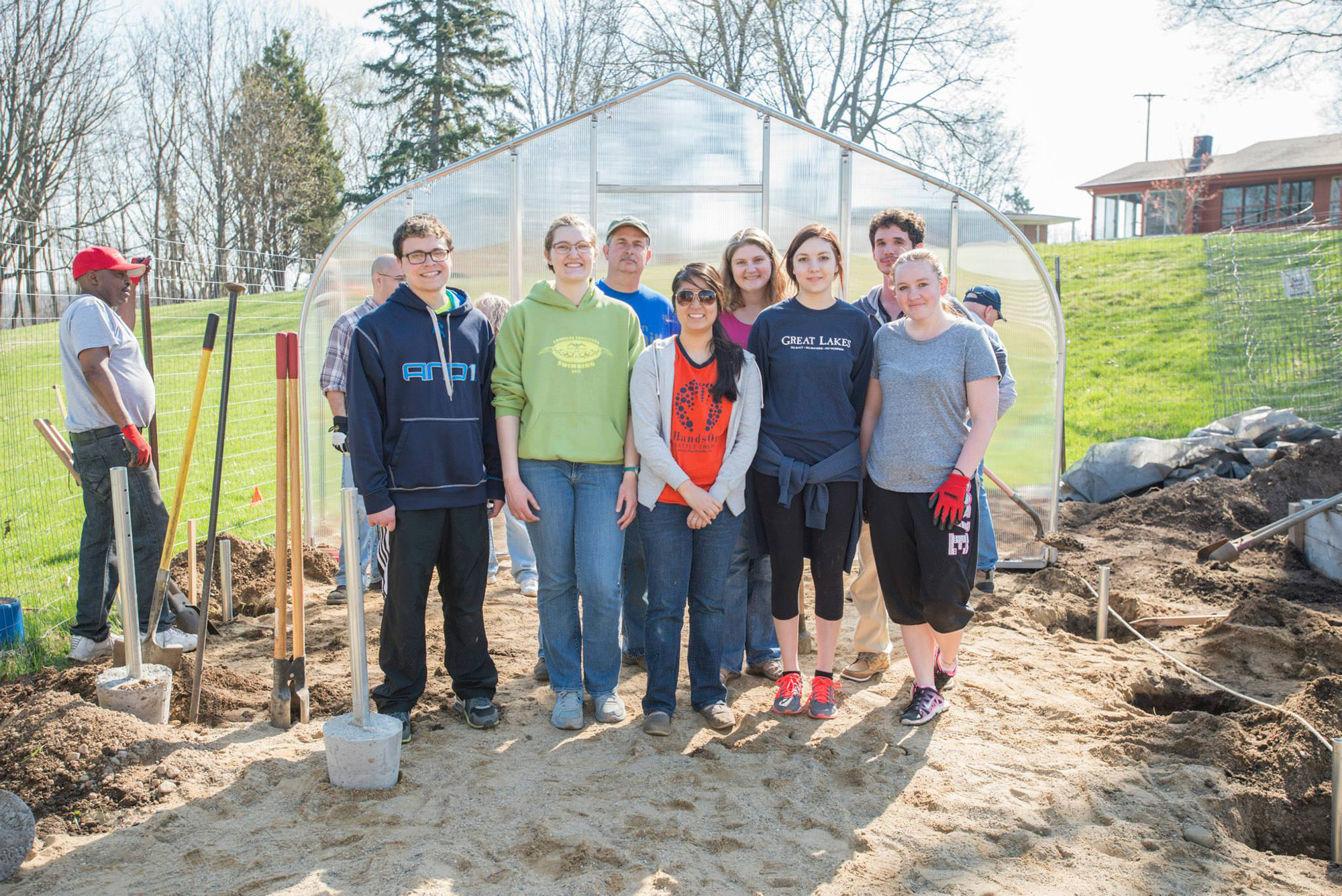 KCC students and employees pose for a group photo while working in the college's community garden on campus