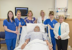 """Pictured with a """"patient"""" simulation manikin in one of KCC's nursing simulation labs are, from left to right, 2015 KCC Nursing graduate Hannah Smith, 2015 KCC Nursing graduate Jessica Harper, KCC Nursing clinical and simulation instructor Lisa Zimmer, KCC Nursing professor Dr. Debra Buck, 2015 KCC Nursing graduate Elizabeth Wagner and scholarship donor Bernita Bartlett."""