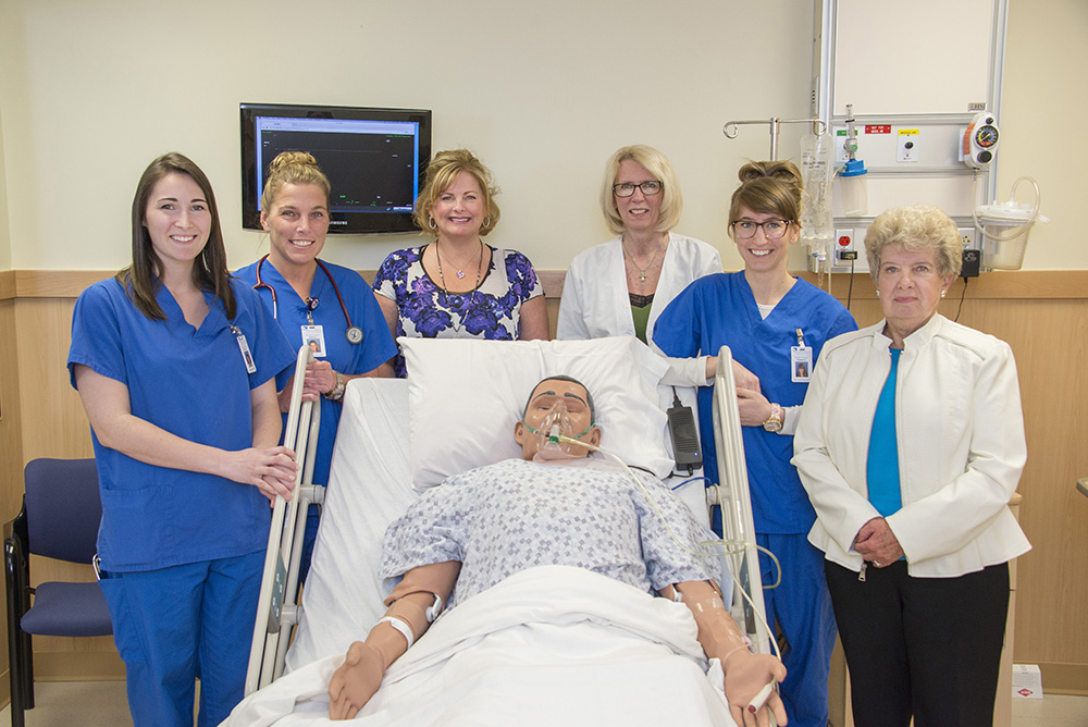 "Pictured with a ""patient"" simulation manikin in one of KCC's nursing simulation labs are, from left to right, 2015 KCC Nursing graduate Hannah Smith, 2015 KCC Nursing graduate Jessica Harper, KCC Nursing clinical and simulation instructor Lisa Zimmer, KCC Nursing professor Dr. Debra Buck, 2015 KCC Nursing graduate Elizabeth Wagner and scholarship donor Bernita Bartlett."