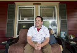 KCC alumnus Jordan Blekking sitting on a porch