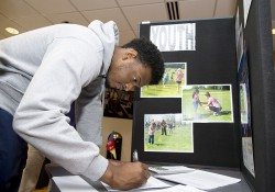A student fills out an information form at the 2014 Volunteer and Civic Engagement Fair