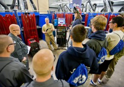 A welding instructor addresses high school students during a manufacturing day at the RMTC.