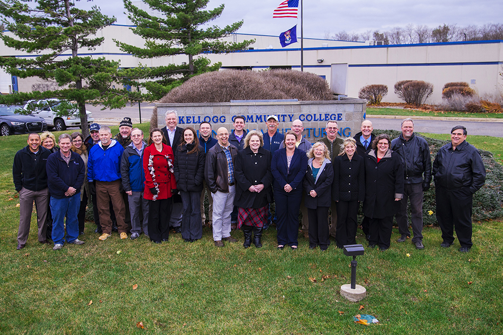 KCC RMTC employees pose for a group photo outside at the RMTC during the groundbreaking ceremony for a new RMTC expansion Nov. 13.