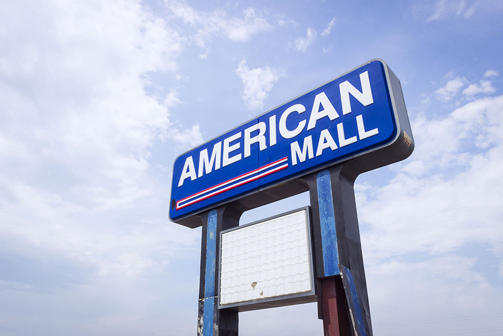 "A sign reading ""American Mall,"" a promo courtesy of Stephen Crompton for his upcoming ""The American Mall"" lecture at KCC."