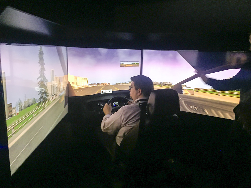 An EMS faculty member trains on a new driving simulator.