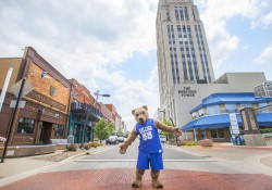 KCC mascot Blaze stands in the middle of a street in downtown Battle Creek.