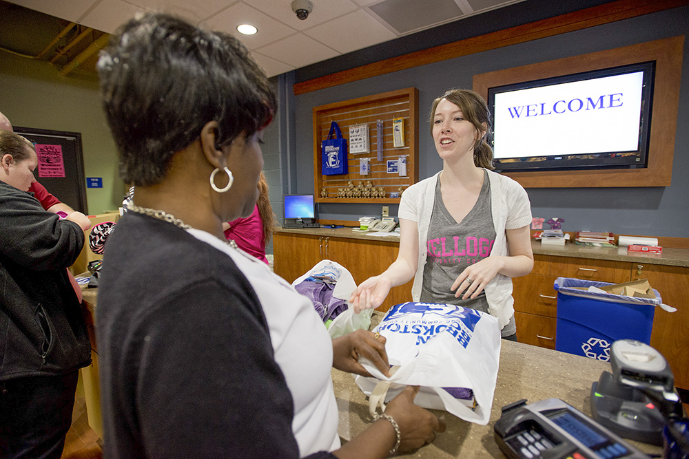 A Bruin Bookstore employee helps a customer check out.