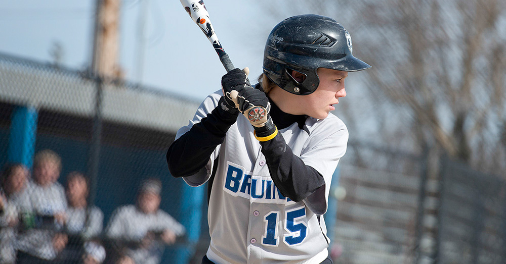 A KCC softball player at bat during a home game.