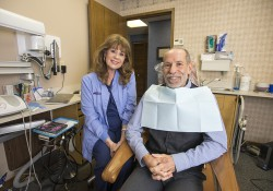 Retired dental hygienist Gail James, left, sits in her exam room at Battle Creek's Halonen Family Dentistry with patient Kevin Rabineau, Dean of Arts and Sciences and Regional Education at KCC. James, who was a member of KCC's first graduating Dental Hygiene class in 1972, saw Rabineau as her last patient before officially retiring from Halonen on Jan. 28. She'd worked as a dental hygienist at the practice since 1981.