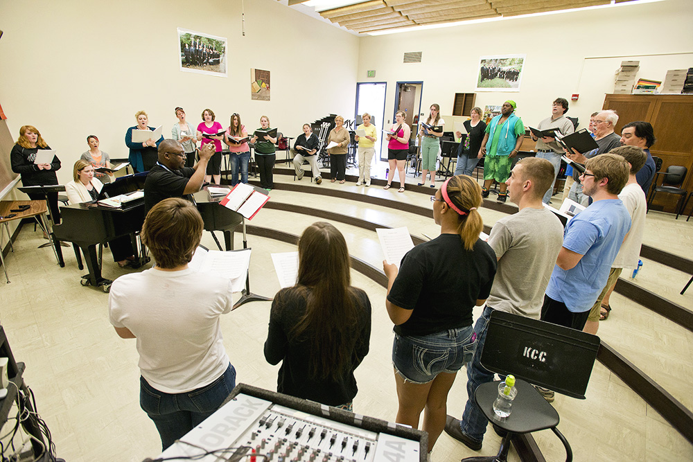 KCC choir members rehearse in a choir room on campus.