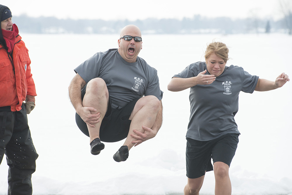 KCC Police Academy cadets jump into Goguac Lake during a Polar Plunge event in January 2015.