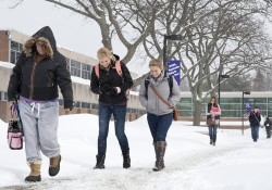 KCC students walk in the snow on the North Avenue campus in Battle Creek.