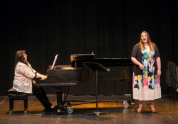 KCC student Amanda Adams sings on stage during a recital.