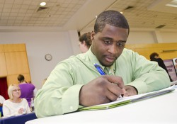 A job fair attendee fills out an application.