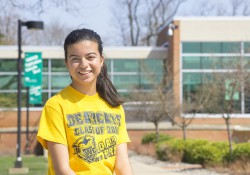 Battle Creek Central High School senior and KCC dual-enrollment student Yarielis Rosario poses near the entrance to KCC's North Avenue campus in Battle Creek.