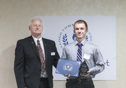 KCC student Dakota Glassburn accepts an award from KCC President Mark O'Connell at the college's annual Awards Banquet April 28.