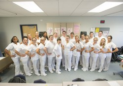 CNA students pose for a group photo during class.
