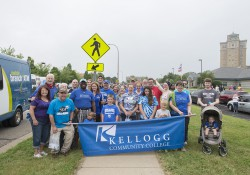 A group of KCC employees and their friends and family members pose for a group photo before walking in the Cereal Parade in 2015.