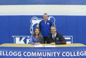 KCC volleyball player Emily Delmotte with Head KCC Women's Basketball Coach Klingaman and Pete Delmotte (father).