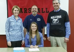 KCC volleyball player Emily Delmotte with, from left to right, Ann Delmotte (mother), Head KCC Volleyball Coach Tom VanWienen and Pete Delmotte (father).