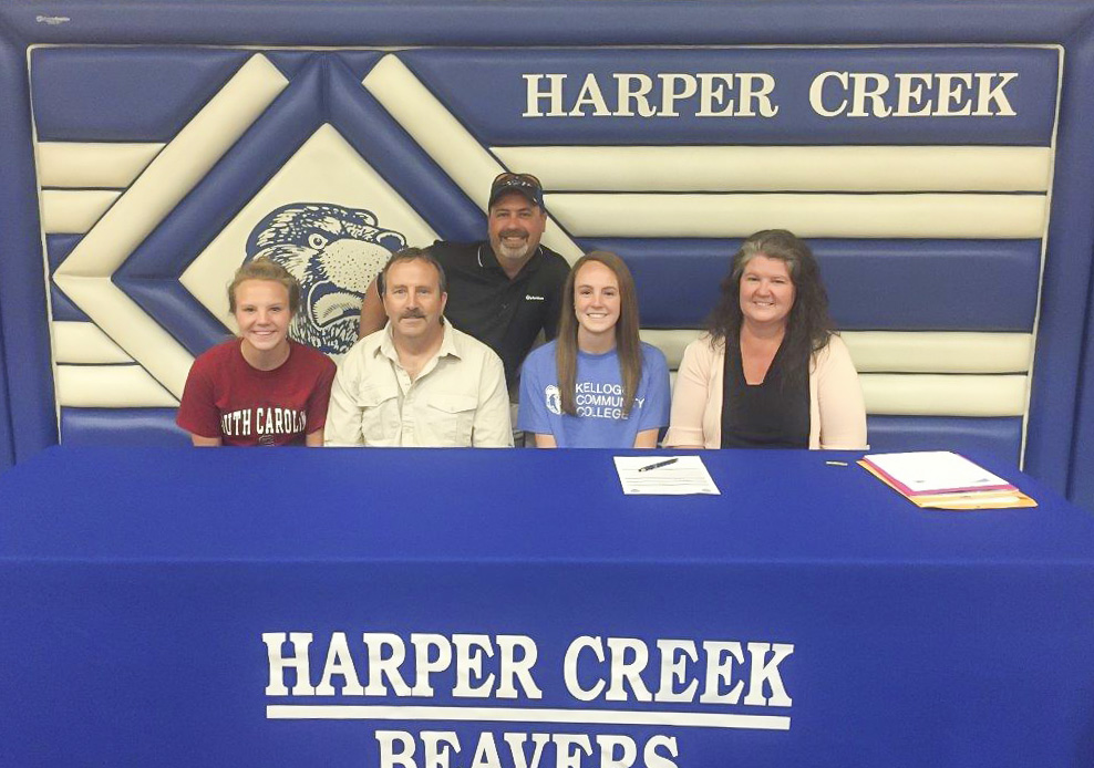 KCC volleyball player Kim Kusler signs a National Letter of Intent to play volleyball at KCC.