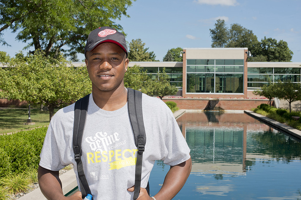 A KCC student stands outside the main entrance to KCC's North Avenue campus in Battle Creek.