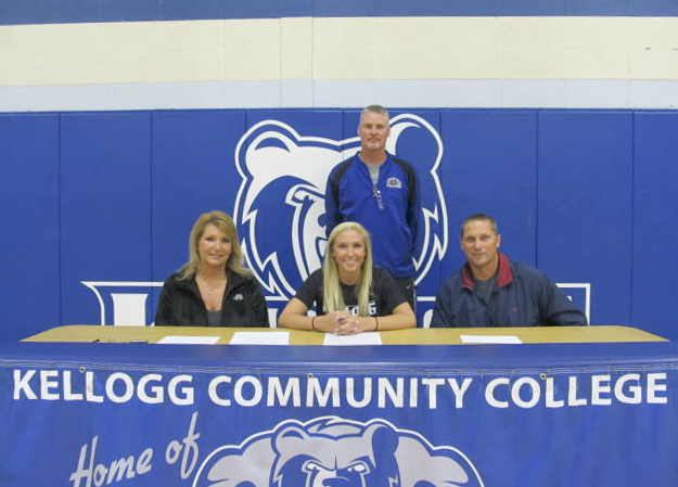 Pictured, from left to right, are Beverly Rook (mother), women's basketball player Kimi Rook, KCC's head women's basketball coach Klingaman and John Rook (father).