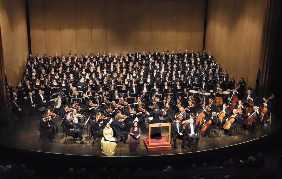 KCC's choirs pose for a formal group photo onstage.