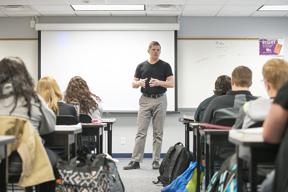 Psychology professor Donn Montgomery leads a class on the North Avenue campus in Battle Creek.