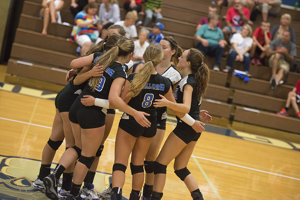 KCC's women's volleyball team huddles after scoring a point during a home match at the Miller Gym.