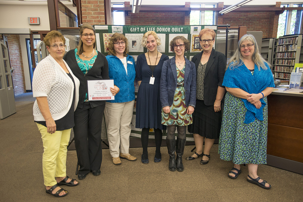 Pictured above, library staff pose with an organ donor quilt in the library following last year's Michigan Libraries for Life event at KCC.