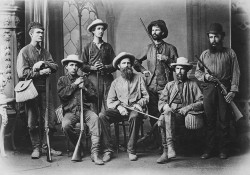 An archival image of hunters posing for a group photo. Part of the Kingman Museum photo archives on display at KCC through the end of 2016.
