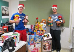 KCC baseball players (left to right) Bailey Peterson and Alex Walton, posing with donated Toys for Tots toys before they were picked up for distribution.