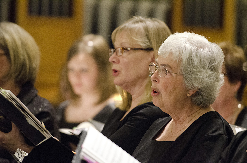 Choir members sing during a performance in Coldwater.