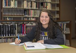 KCC student Brittany Doyle poses for a photo in the KCC library.